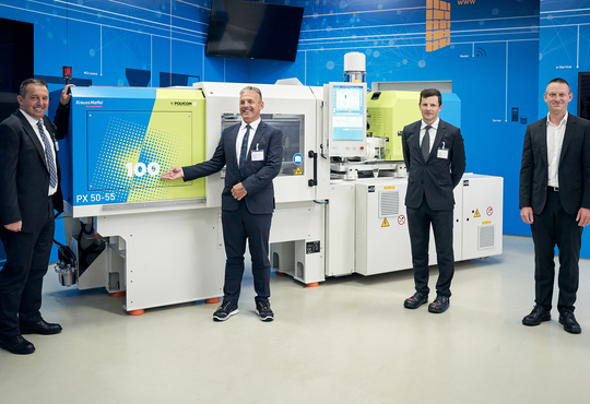 Anniversary machine: KraussMaffei delivers 100th injection molding machine to Polycom